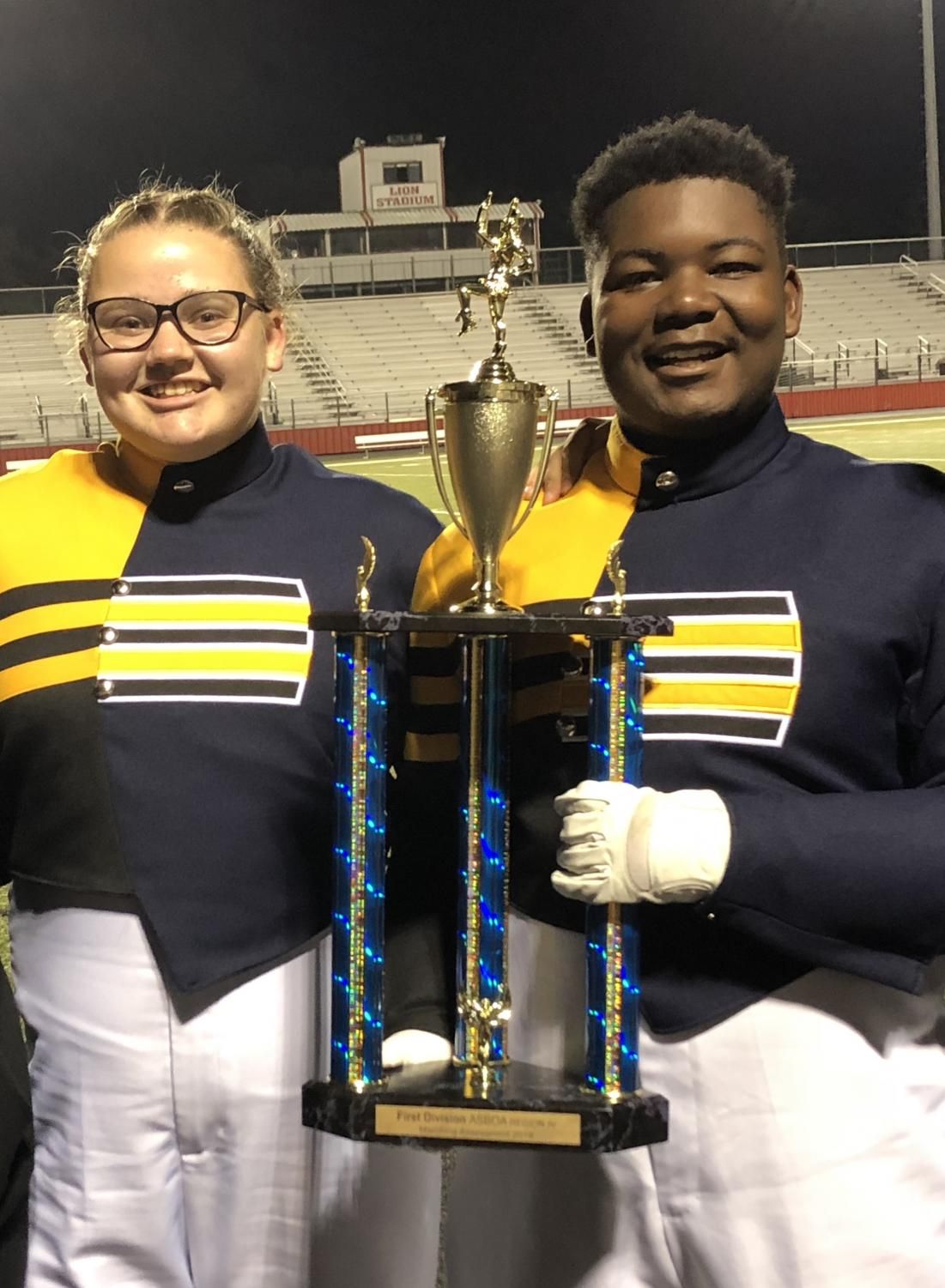 Drum Majors Catherine Arnold and Markell Cox  with the Regional Trophy