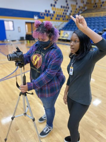 Photographers, Darby Weaver and Skyla Davis cue clubs for yearbook pictures